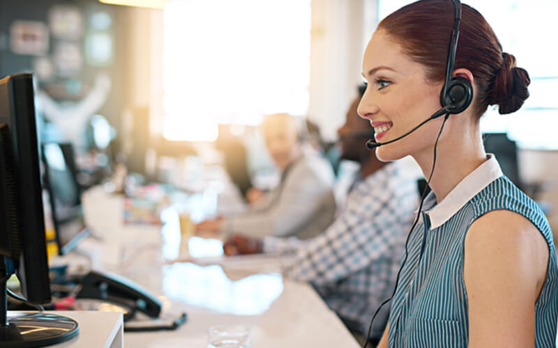 Smiling customer service representative with headset
