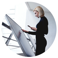 Businesswomen working from large display