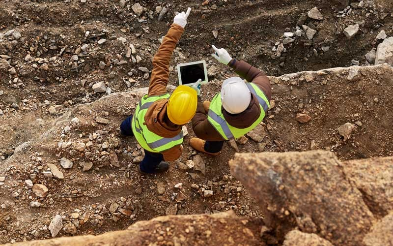Construction worker on tablet device outside